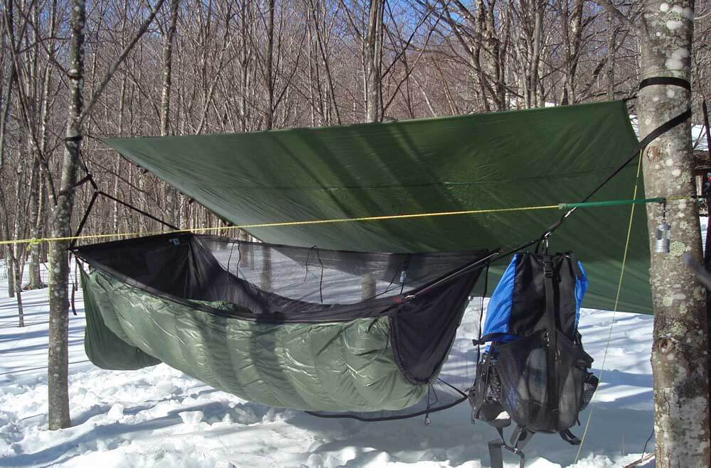 Hammock camping in cold weather is an advanced skill, perhaps even more so than ground camping in the same weather. For beginner hammock campers, test your system on low-risk, short-term outings first in order to develop your skills and know-how. Note the full-length under quilt for winter temps. Photo by Jack Tier of Jacks 'R' Better.