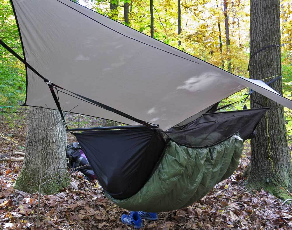 In less windy or rainy conditions you can use a higher and airier tarp pitch. Notice the under-quilt, which like a topside quilt will help to reduce convective heat loss.