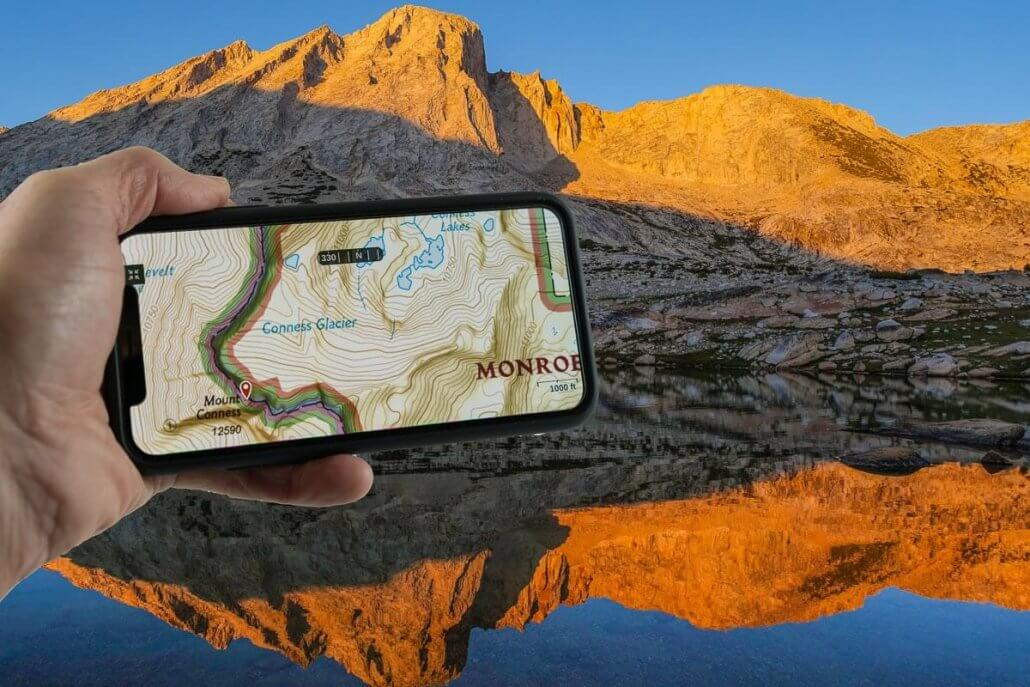 gaia gps | hiking gps iphone with mountain in the background
