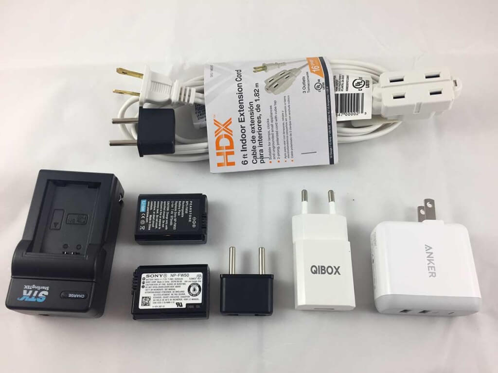 Key items are a $2 extension cord that when combined with a cheap 2-prog travel adapter gives you 3 US style outlets. I find that the Anker 2 port (2 amp each) charger is fast and dependable. And in truth, the QIBOX charger is not as good as a 2 amp US charger with the cheap 2 prong travel adapter.