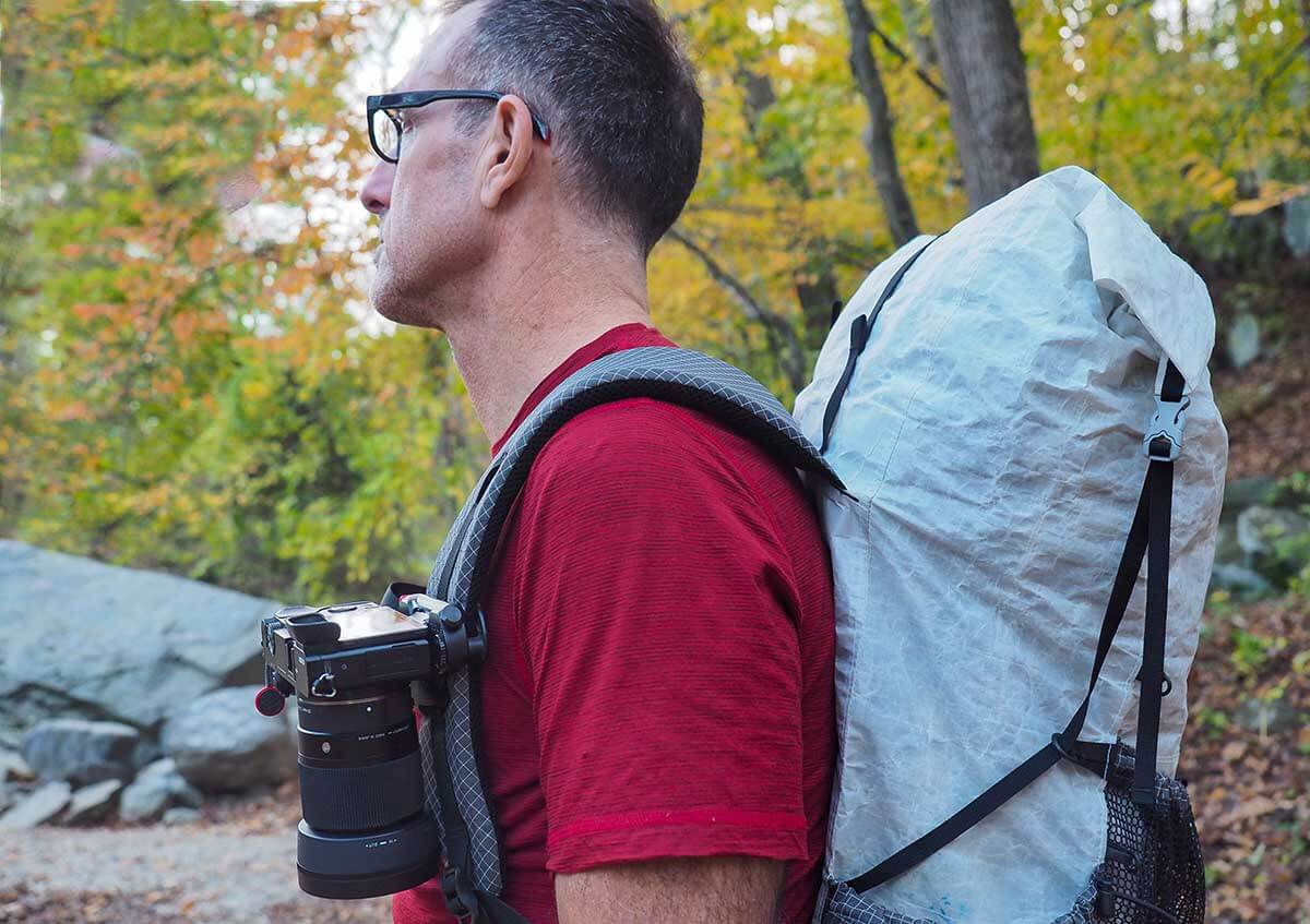 For me the maximum weight of a camera is determind by what I an comfortably carry on the shoulder strap of my pack.