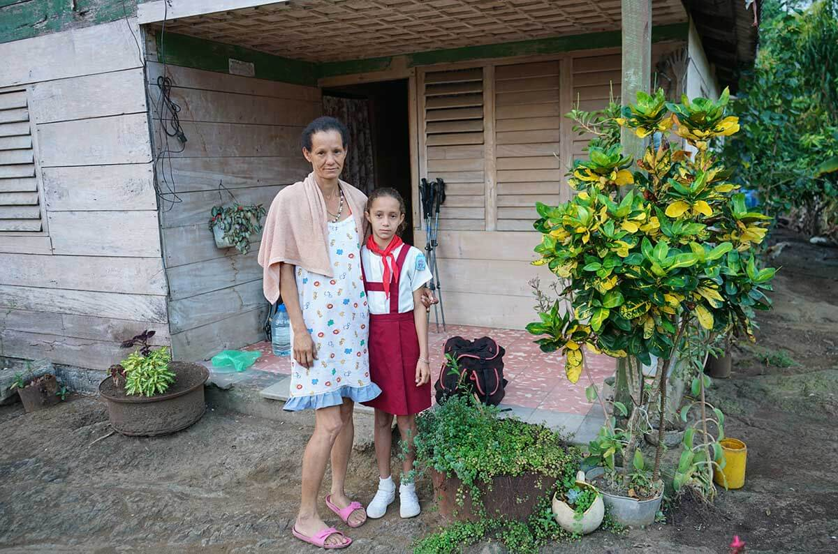 Mother and daughter of our host family. Daughter is in school uniform and ready to head out.