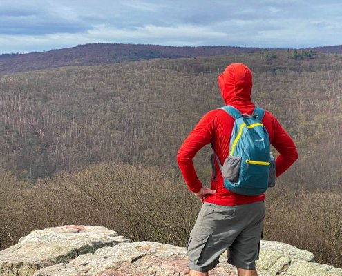 HIKPRO 20L Pack Review - cliff top view of hiker wearing pack
