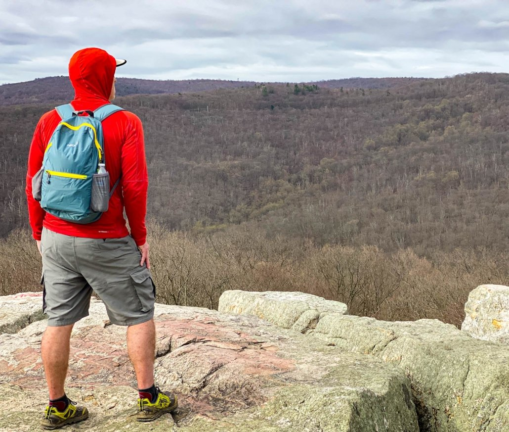 HIKEPRO 20L Backpack - cliff top view of hiker wearing pack
