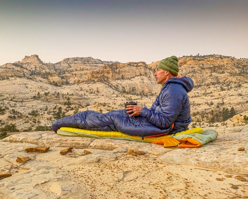 enlightened equipment enigma backpacking quilt morning coffee on slickrock