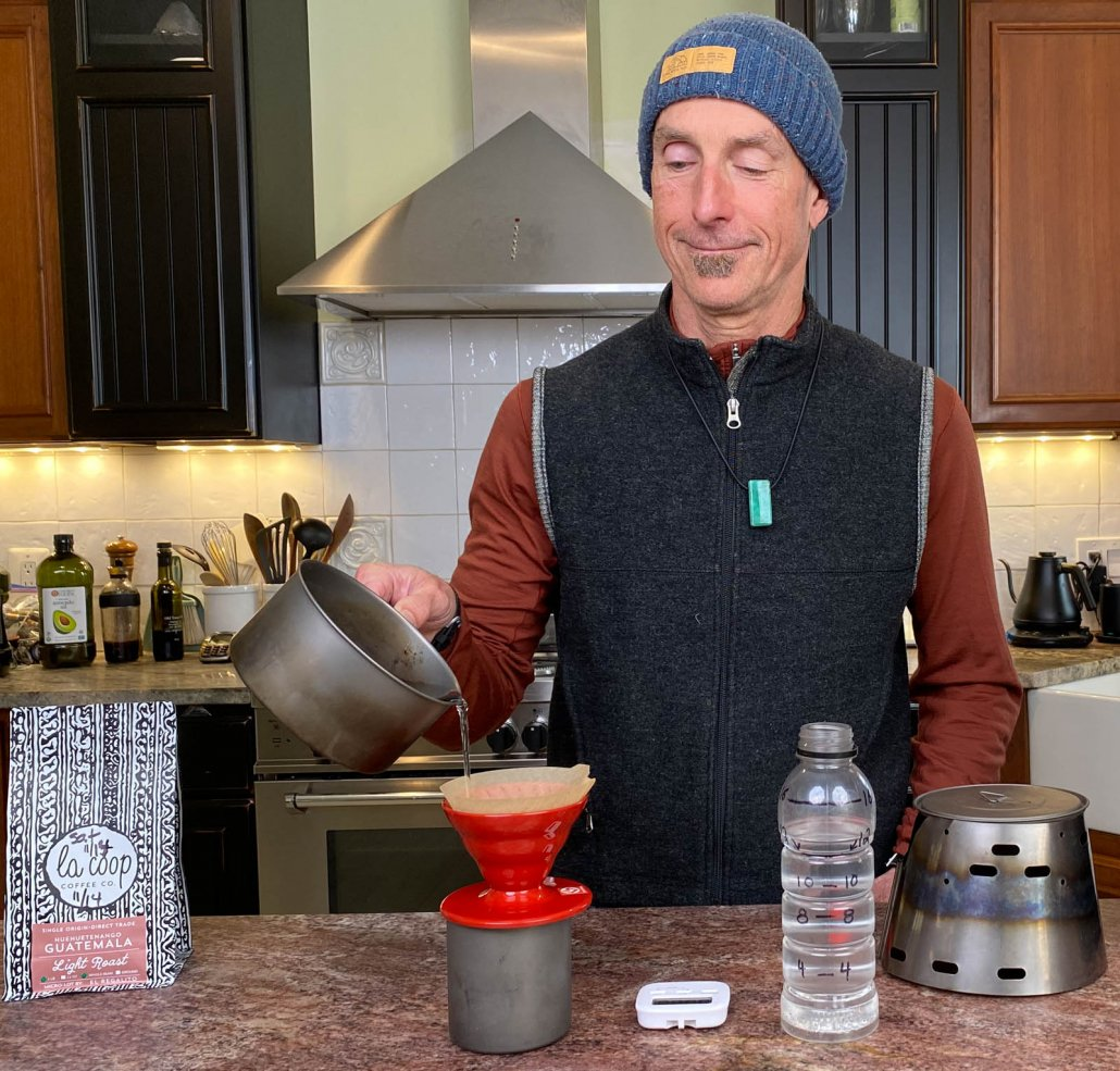 Alan making cowboy coffee using the pour over coffee maker method