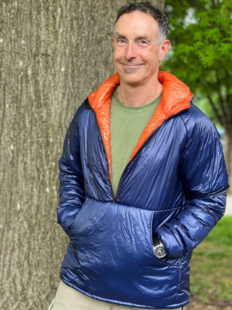 Enlightened Equipment Torrid Pullover review showing hood down