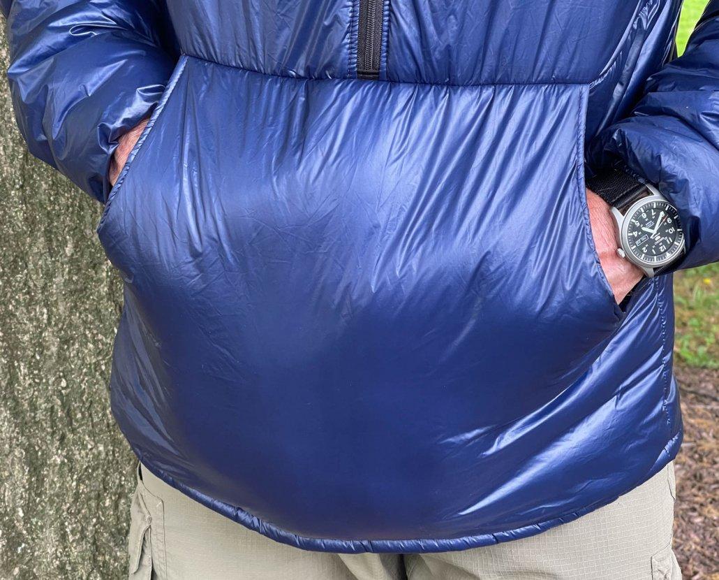 enlightened equipment torrid pullover review highlighting kangaroo pocket detail horizontal